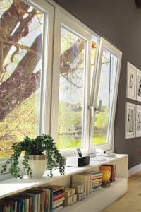 A bank of tilt & turn windows with one tilted open from the top to provide ventilation.