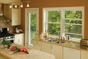 kitchen with double hung sliders over a counter and double sink